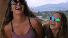 Three attractive teenage girls with long hair laughing in slowmo Stock Footage