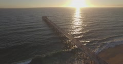 Flying Over the Ocean Panning Down on the Hermosa Beach Pier Stock Footage