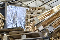 Waste wood from pallets stacked in the storage room - stock photo