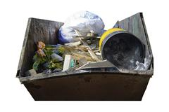 Dumpster with industrial waste isolated on white background Stock Photos