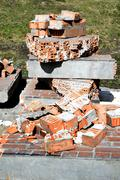 Pile of discarded bricks from construction site Stock Photos