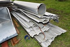 Metal parts are dismantled structures stored in the soil on the territory of Stock Photos