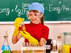 Child in chemistry class. Stock Photos