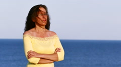 Slow motion. Adult serios woman in spectacles with  and blue sea sea - stock footage