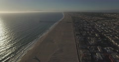 Flying North Along The Strand Towards the Hermosa Beach Pier With Pan Down Stock Footage