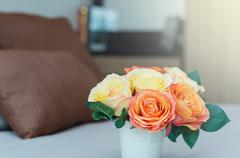 Luxury Interior bedroom with artificial rose flower on bed - stock photo