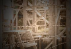 Barbed Wire Fence border the dangerous area Stock Photos
