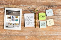 Close up of notebook, stickers and tablet pc Stock Photos