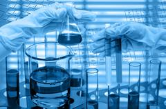 Chemical Laboratory,Hand holding the tube and test flask Stock Photos