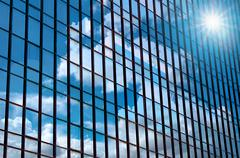 Closeup building glass of skyscrapers with cloud, Business concept of archite Stock Photos