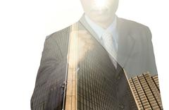 Double exposure of businessman with cityscape, Modern glass Business building - stock photo