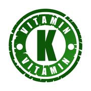 Green round rubber stamp with vitamin K Stock Illustration