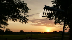 Sunset time lapse behind small Dutch windmill Stock Footage