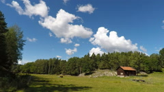 Idyllic meadow and traditional barn in Stockholm archipelago Stock Footage