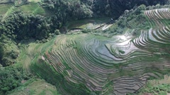 EPIC CINEMATIC REVERSE AERIAL OF THE REFLECTION OFF THE PINGAN RICE FIELDS Stock Footage
