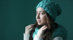 Beautiful young woman in a turquoise knitted hat and scarf Stock Footage