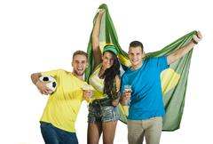 A group of Brazilian football or soccer supporters celebrating. Kuvituskuvat