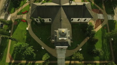 Aerial Shot of European Medieval Church in middle of European Town Stock Footage
