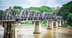 Old metal railroad bridge at Kanchanaburi Thailand Stock Photos