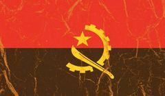 Angola flag painted on crumpled paper background - stock photo