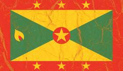 Grenada flag painted on crumpled paper background Stock Photos