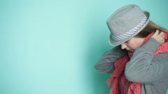 Beautiful woman in the hat wears a scarf Stock Footage