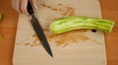Cutting courgette on the table. Stock Footage
