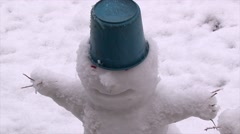 Portrait of a smiling snowman with a bucket on his head closeup Stock Footage