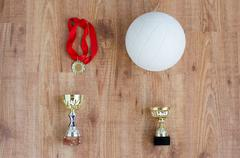 Close up of volleyball ball, cups and medals Kuvituskuvat