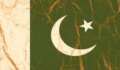Pakistan flag painted on crumpled paper background - stock photo