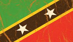 St Kitts and Nevis vintage flag on old crumpled paper background Stock Photos
