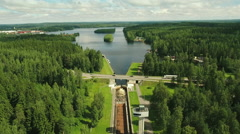 Aerial Shot of Tugboat towing Barge in Canal Surrounded by Forest Stock Footage