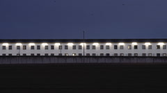 Facade of a prison in the early morning Stock Footage