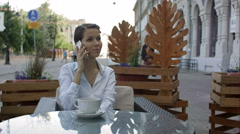 Female calling via mobile phone to her partner for tell about the monthly income Stock Footage