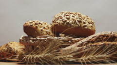 Bakery bread on a wooden table, rotating - stock footage