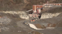 Heavy machinery working in stone pit Stock Footage