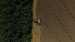 Harvester unload wheat aerial shoot Stock Footage