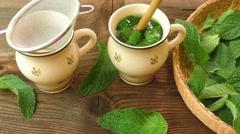 Healthy herb tea prepare. Fresh made Mint Tea Stock Footage