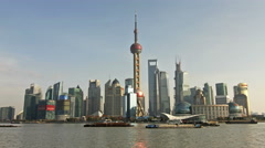 Time lapse of Shanghai skyline and busy Huangpu river Stock Footage