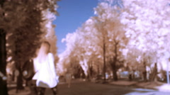 Infrared video surveillance in a park with people Stock Footage