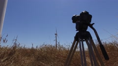 dslr camera making timelapse eolic windmill turbine 4k - stock footage