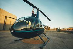 Pilot inspecting the rotor blades of a helicopter Stock Photos