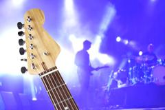 Guitar neck over concert stage Stock Photos