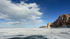 Movement of the clouds over the icy Lake Baikal on Olkhon Island, Irkutsk region Stock Footage