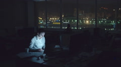 Tired Woman Working in Office at Night Stock Footage