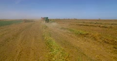 Tractor plowing wheat Stock Footage