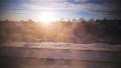 View from the railroad window. Russia. Winter sunrise. Passing by a village Stock Footage