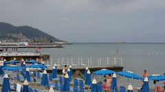 Umbrellas on the beachin Diano Marina Italy Stock Footage