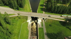 Aerial Shot of Artificial Canal Floodgates Surrounded by Forest Stock Footage