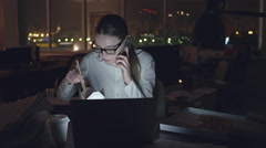 Businesswoman Spending Night at Office Stock Footage
